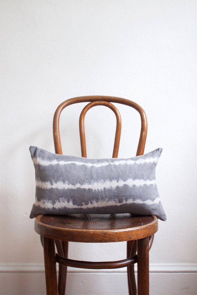 Handmade gray tie-dye lumbar pillow.