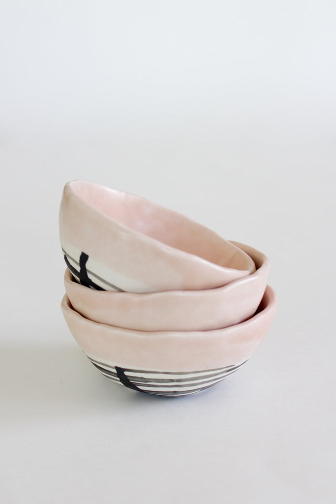 Handmade porcelain clay small pinch bowls in peach.