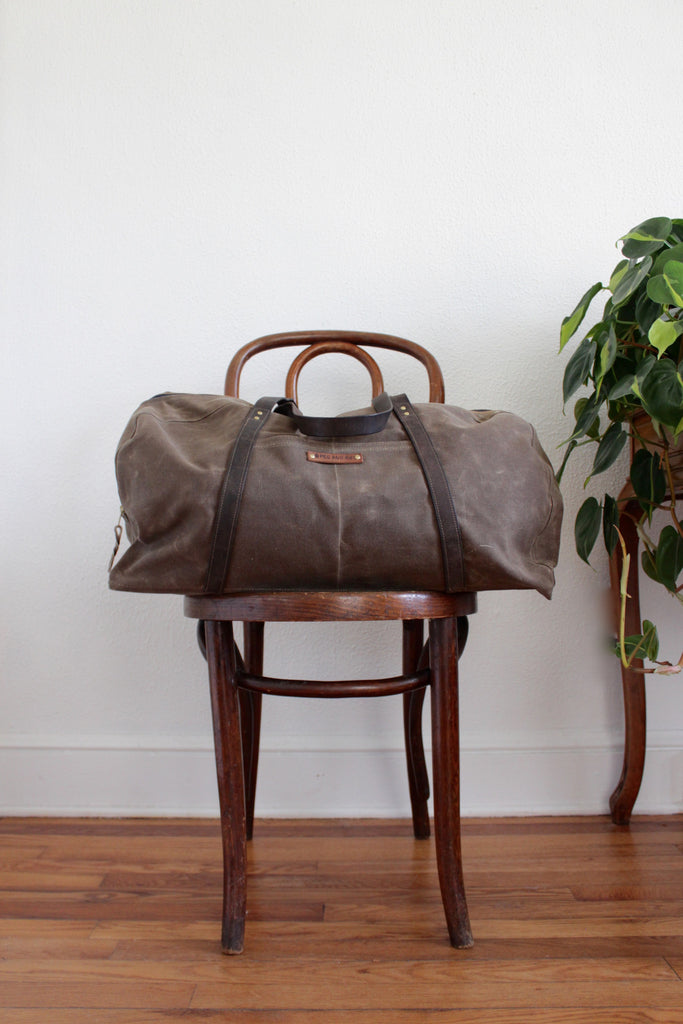 Reclaimed leather and waxed canvas weekender.