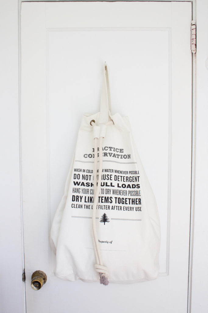 Cotton canvas laundry tote with strap made by Izola.