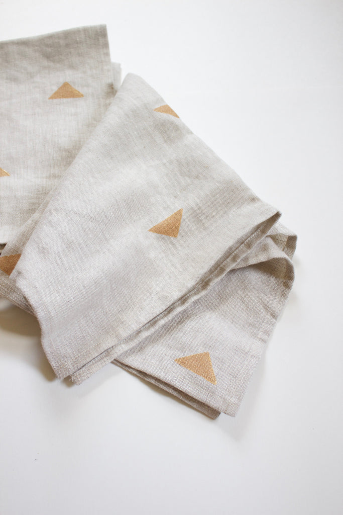 Set of four linen napkins with hand block printed design.