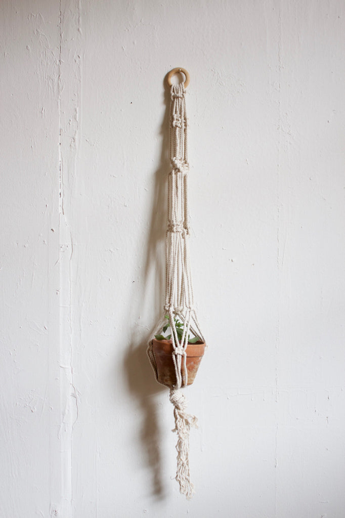 Hand made in the USA hanging macrame planter.