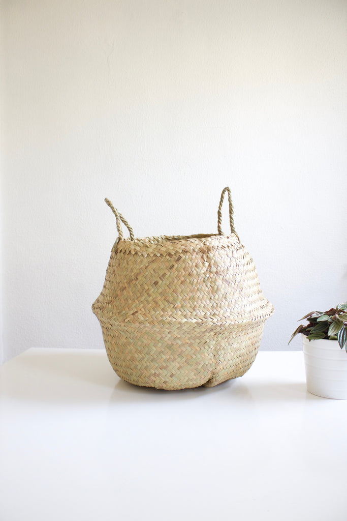 Hand woven natural seagrass basket, sourced fairly.