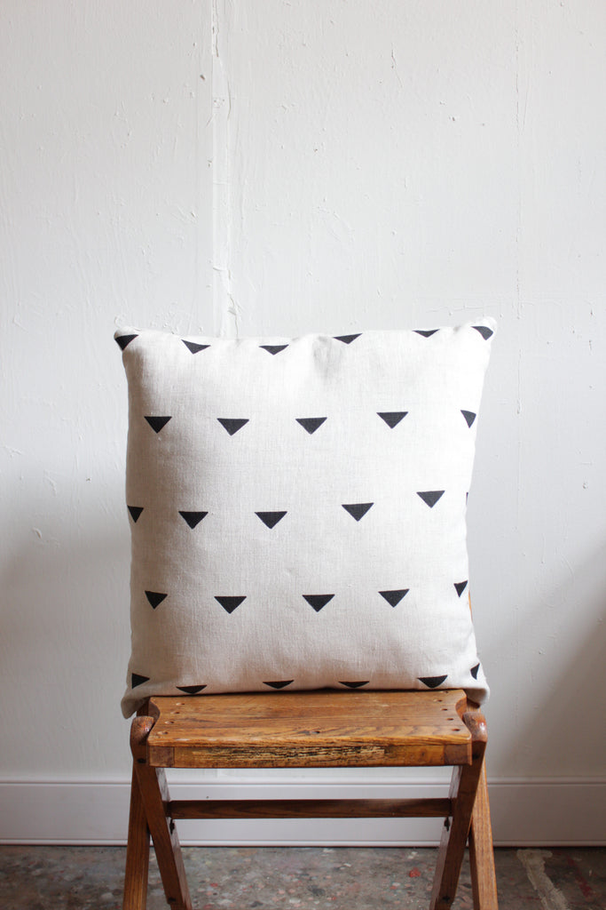 Caroline Z. Hurley linen triangle block printed pillow.