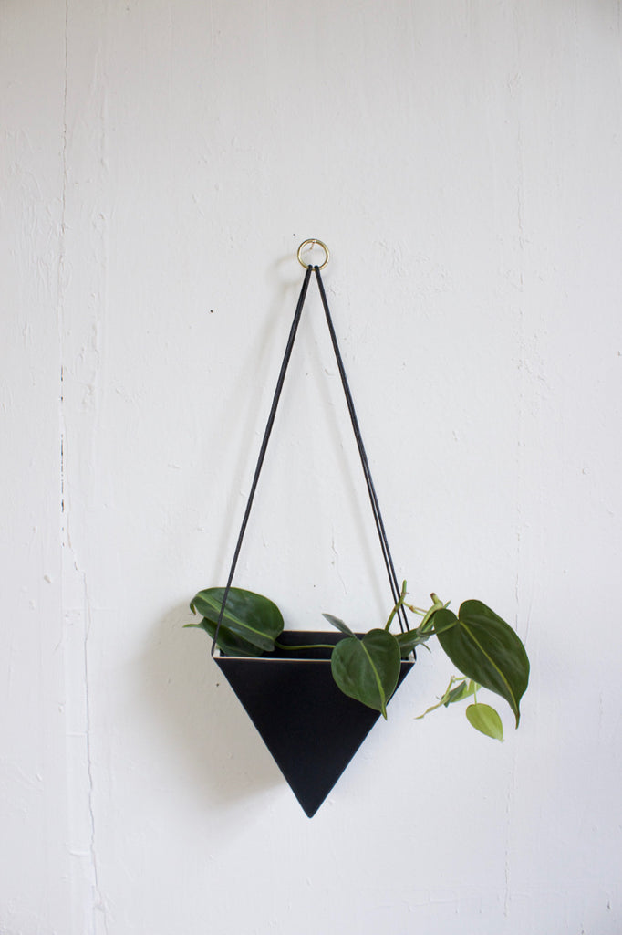 Handmade porcelain hanging planter in black.