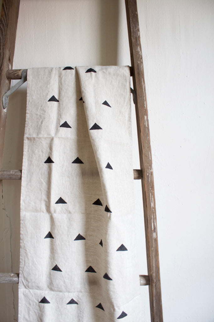 Triangle block printed linen table runner.