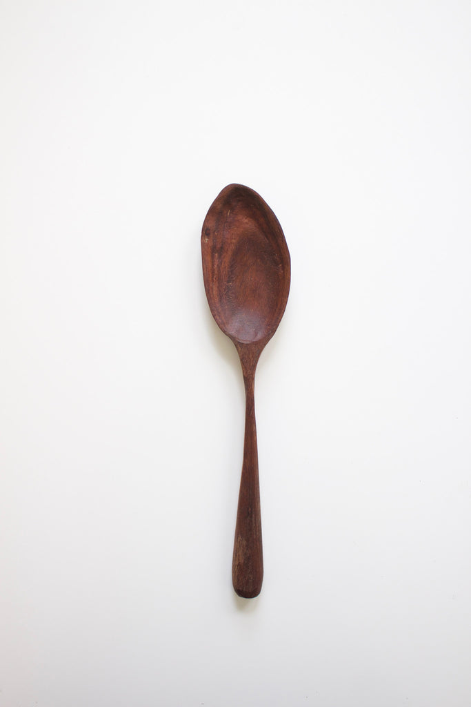 Hand carved walnut wood spoon.