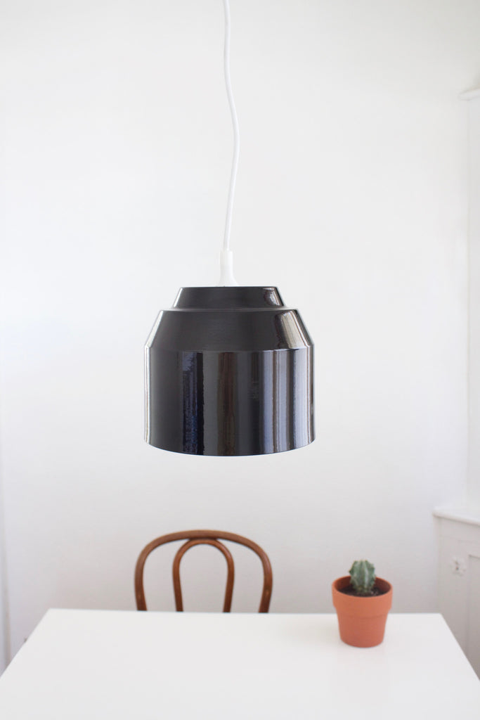Black pail pendant light hand spun from metal by Yield.