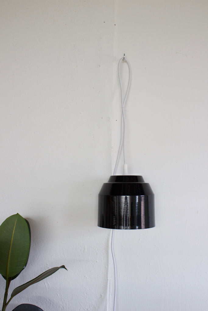 Black modern pendant hanging light by Yield.