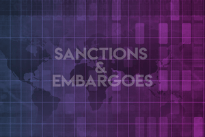 Sanctions and embargoes text on colored background