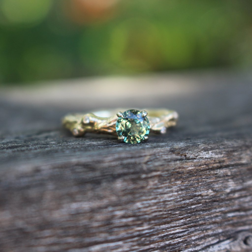 Green sapphire nature inspired engagement ring
