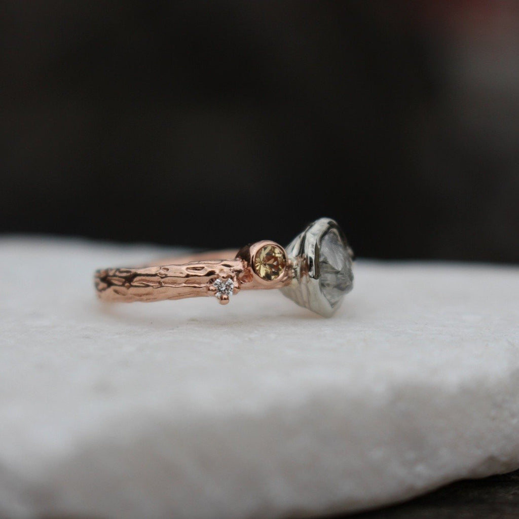 Rough diamond leaf and branch engagement ring