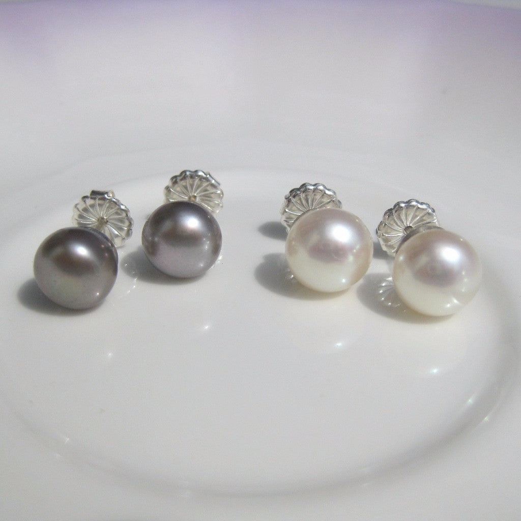 A girl's staple - pearl studs