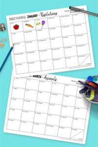 printed creative calendars with daily doodle prompts on marble desktop