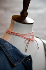Shop CLASSIC PEARL WRAP NECKLACE IN PINK -- As You Go Boutique