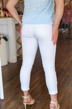 WHITE TULIP HEM SKINNY JEANS - As You Go Boutique