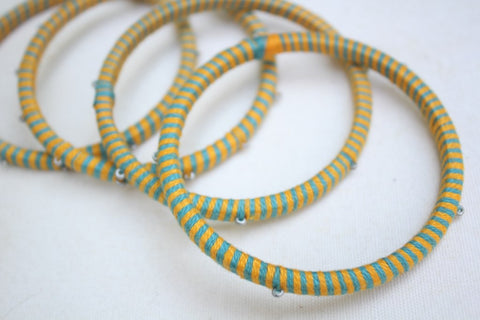 Glass Bangles with thread work