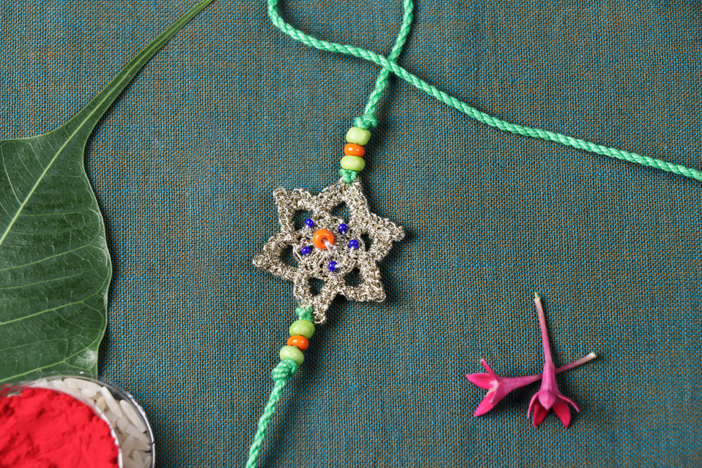 Handmade Silver Metallic Thread Star Crochet Rakhi by Samoolam