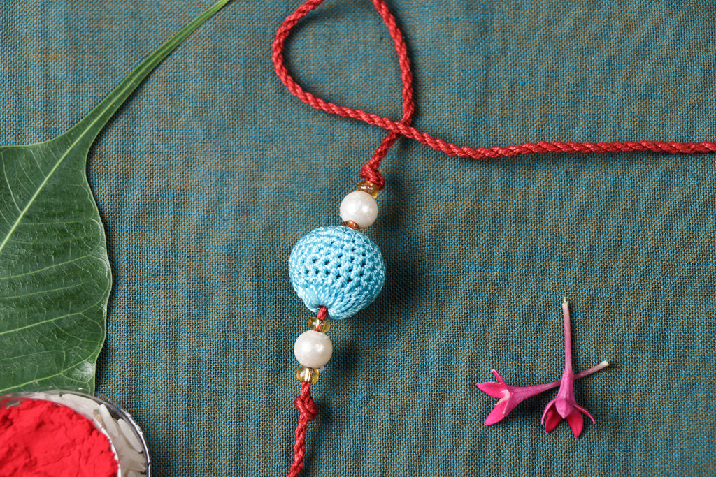 Handmade Ball Crochet Rakhi by Samoolam