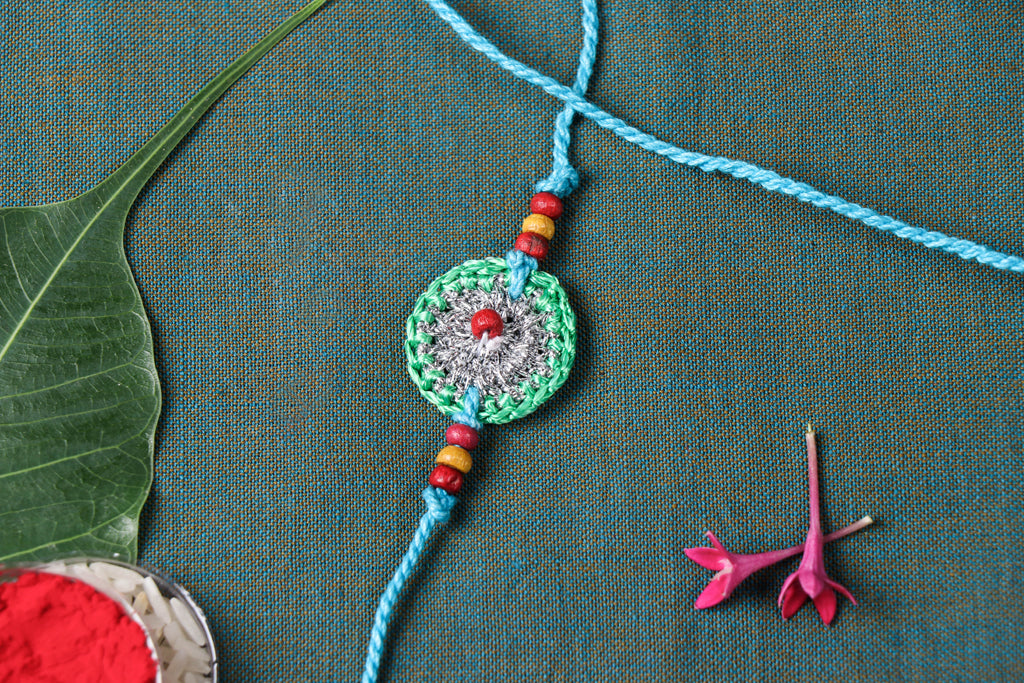 Handmade Silver Metallic Thread Crochet Rakhi by Samoolam