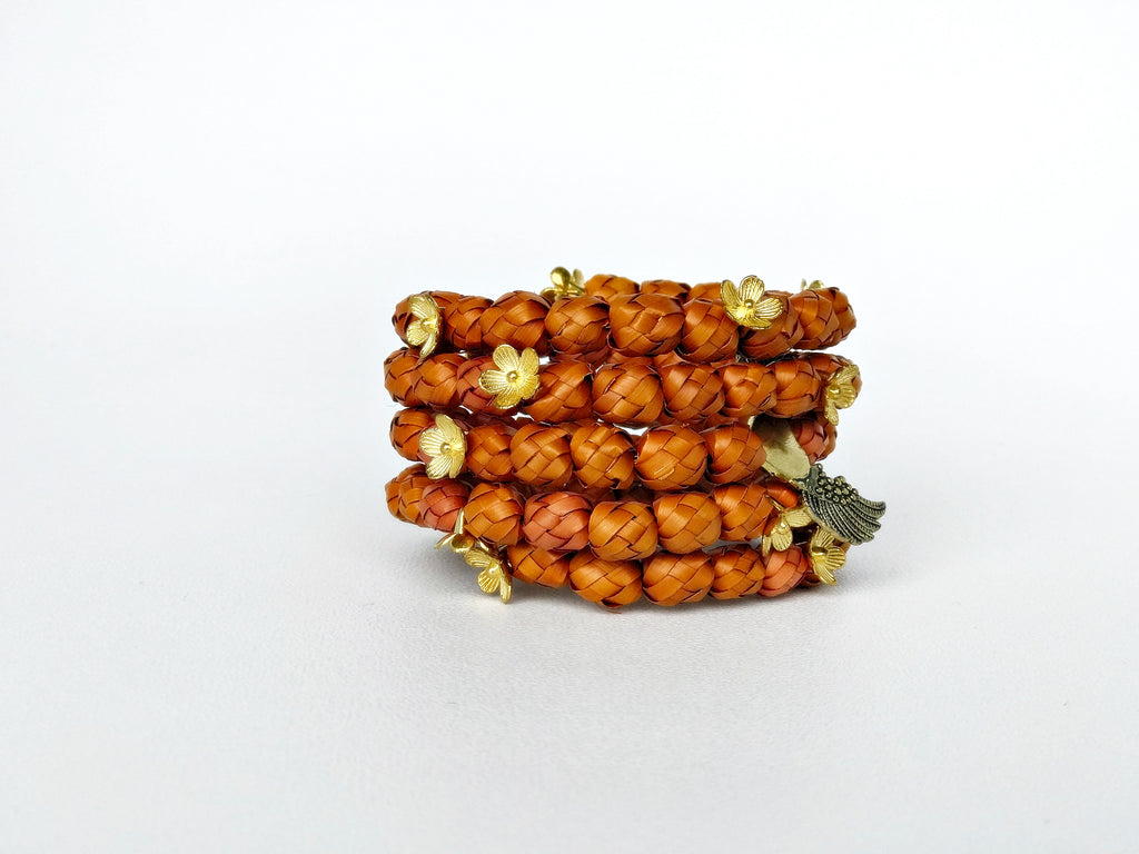 Orange palm leaf bracelet