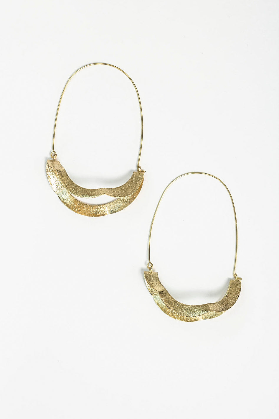 Golden twisted hoop earrings