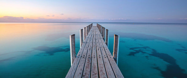 Photograph of a jetty in Dunsborough, Australia at sunset.