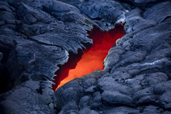 Hawaiian Landscape Photography by Lijah Hanley. A River of Kilauea Lava is visible through a crack on the Big Island of Hawaii.
