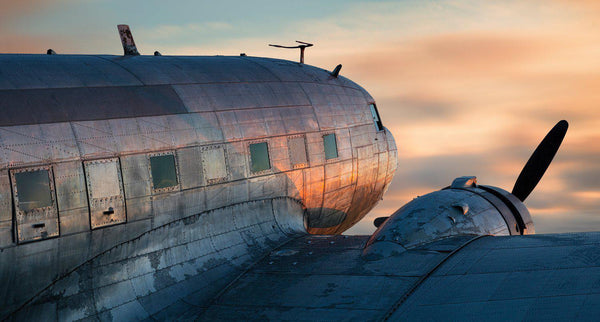 Fine art aviator photography of a DC-3 or C-47 at sunset.