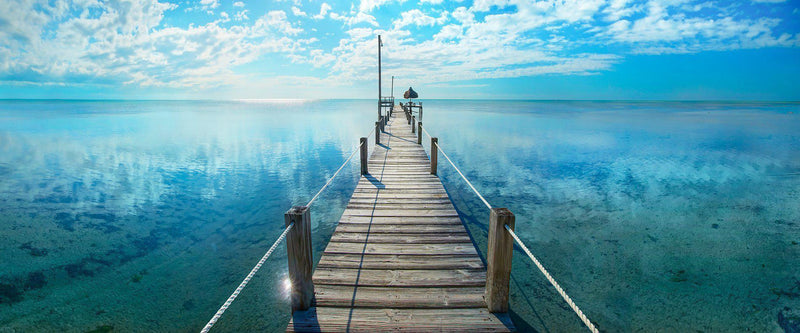 Photograph of a pier in the tropical florida keys.