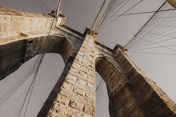 Looking up at the archways of the Brooklyn Bridge in New York