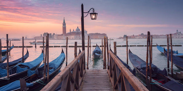 Boats in Venice at sunrise. By Lijah Hanley.