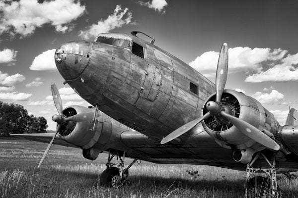Fine art aviation photography of a dc-3 or c-47 in a field in black and white.