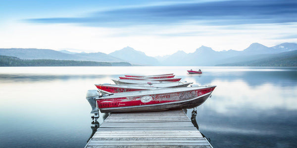 Red boats on Lake McDonald in Glacier National Park. By Lijah Hanley.