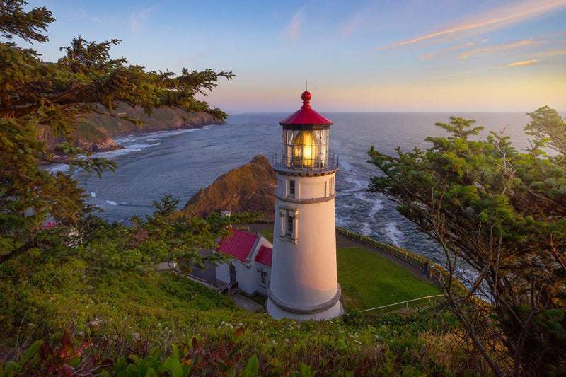 Heceta head lighthouse at sunset on the Oregon coast. By Lijah Hanley.