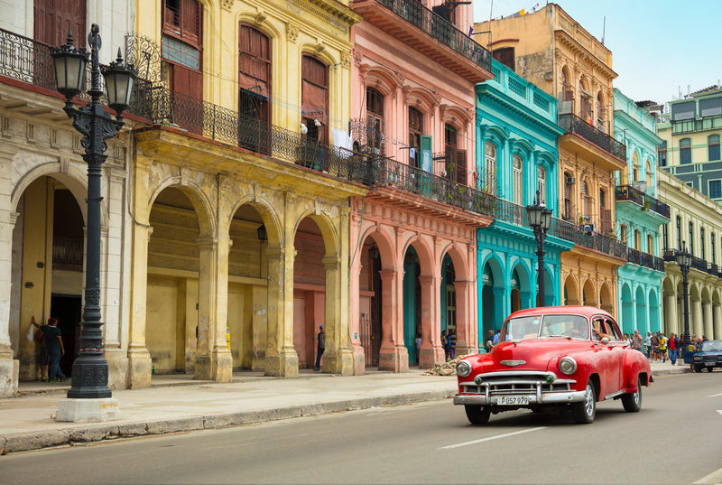 old cars driving in Havana Cuba