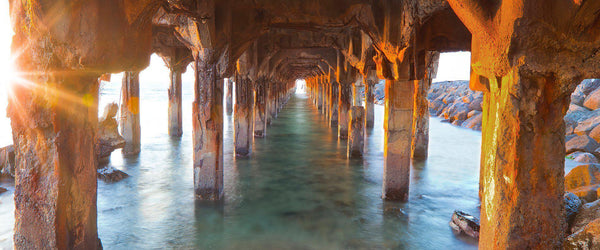 Hawaiian landscape photography by Lijah Hanley. Sunset under the mala wharf in Lahaina, Maui.