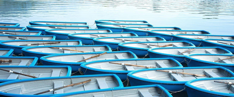 Photograph of row boats lined up in Kyoto Japan.