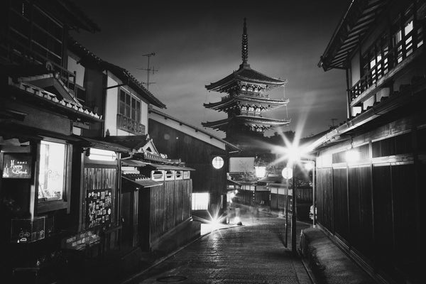 A pagoda viewed from the streets of Kyoto at night