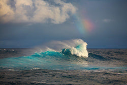 Fine art photographs of large waves and a rainbow at Jaws on Maui Hawaii.