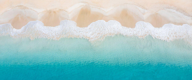 Aerial photograph of waves in Dunsborough Australia.