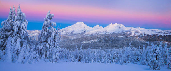 Photograph of the Three Sisters Mountains in the snow near Bend Oregon.