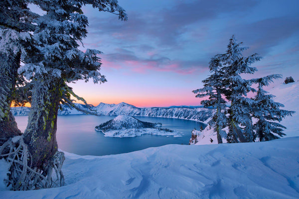 Crater Lake in the snow at sunrise