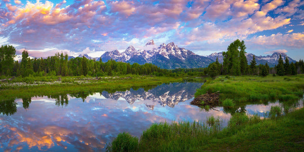 The Grand Teton mountains reflecting in a river at sunrise. By Lijah Hanley.