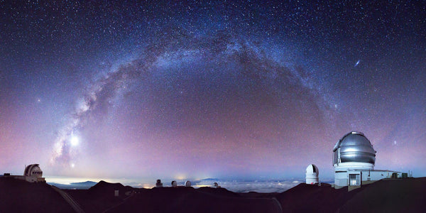Observatories on the top of Mauna Kea under the Milky Way on the Big Island of Hawaii.