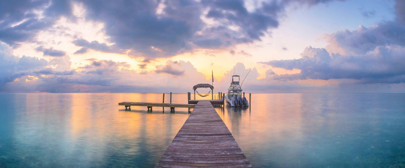 Photograph of a dock in the Florida keys at sunrise.