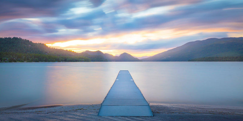 Dock on whitefish lake in montana at sunset.