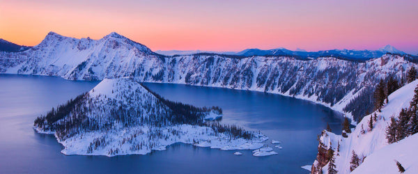 Photograph of wizard island in Crater Lake, Oregon at sunrise.