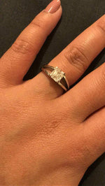 A 1.14ct D VVS asscher cut diamond solitaire on a split shank ring