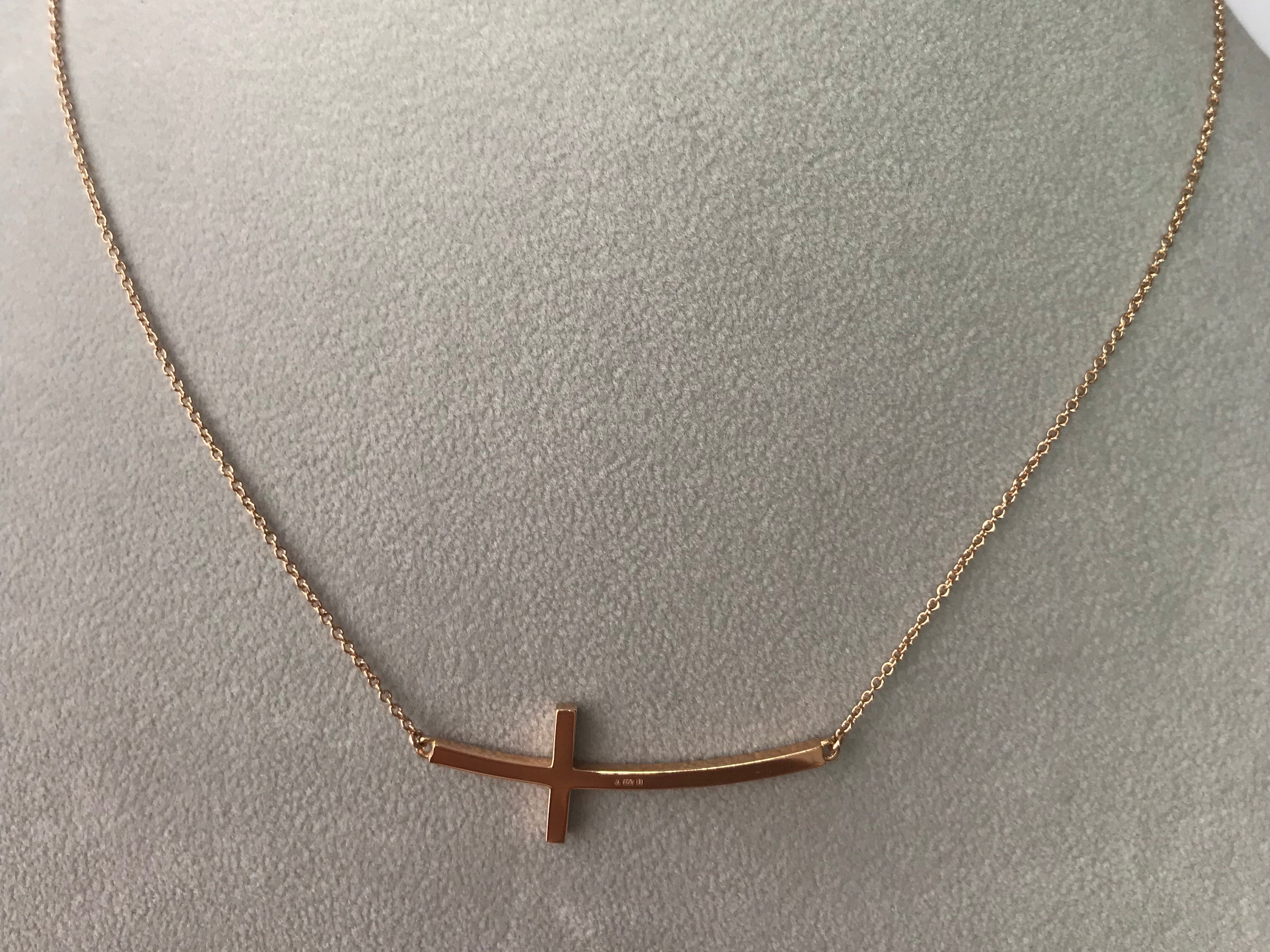 A 18k yellow gold CROSS across necklace